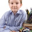 Boy does homework on a table - Stock Photo