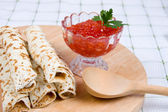 Pancakes with red caviar on a plate. — Stock Photo
