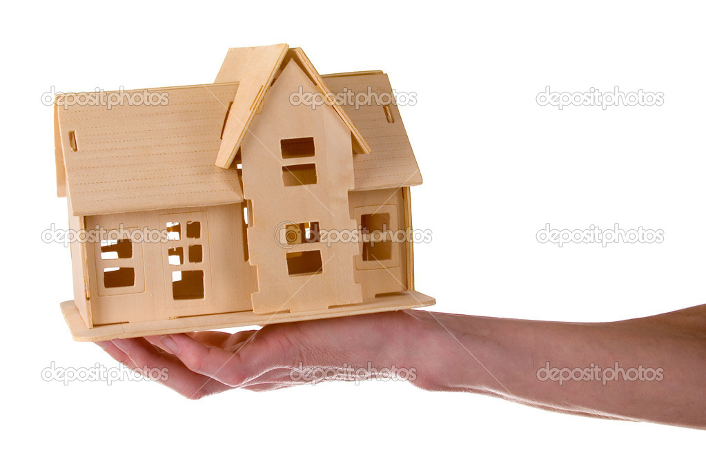 Hand holding a wooden house isolated on white background  Stock Photo #8877788