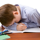 Boy sleeps at the table — Foto Stock