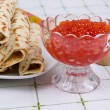 Pancakes with red caviar on a plate — Stock Photo