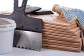 Ceramic tiles and trowel for repairs — Stock Photo