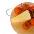 Yellow cheese with fresh tomatoes — Stock Photo