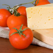 Stock Photo: Yellow cheese with fresh tomatoes