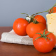 Yellow cheese with fresh tomatoes — Stock Photo