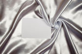 White card on silk — Stock Photo