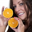 Woman Holding Orange Slices — Stock Photo #10227564