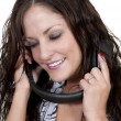Beautiful Woman listening to Headphones — Stock Photo