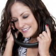 Stock Photo: Beautiful Woman listening to Headphones