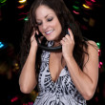 Beautiful Woman listening to Headphones — Stock Photo #10228458