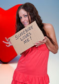 Woman Holding a Sign — Stock Photo