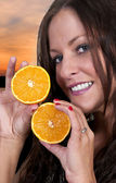 Woman Holding Orange Slices — Stock Photo
