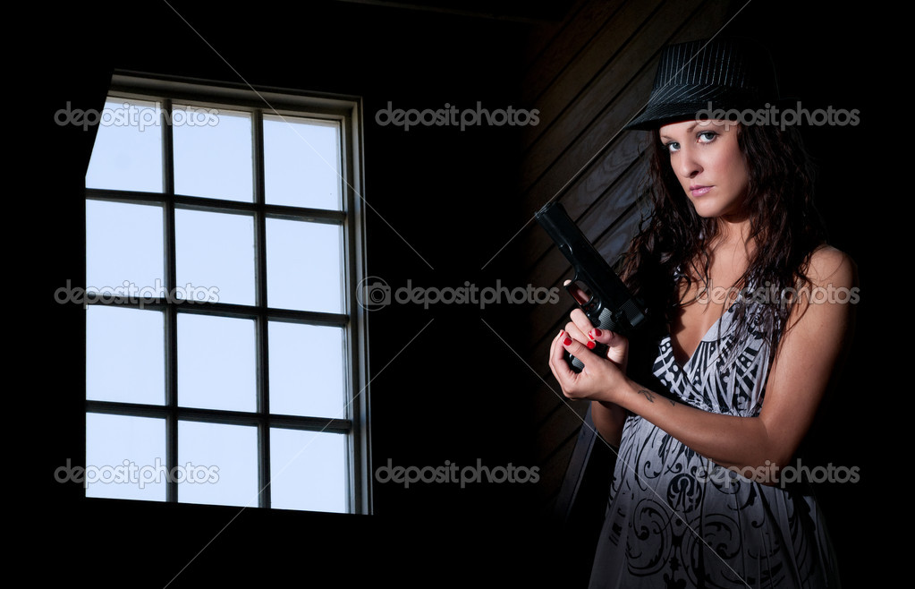 A beautiful police detective woman on the job with a gun  Stock Photo #10228140