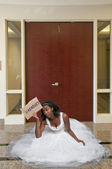 Unemployed Black woman in wedding dress — Stock Photo