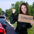 Royalty-Free Stock Photo: Woman Hitch Hiking to a Concert