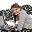 Foto Stock: Woman Using Laptop