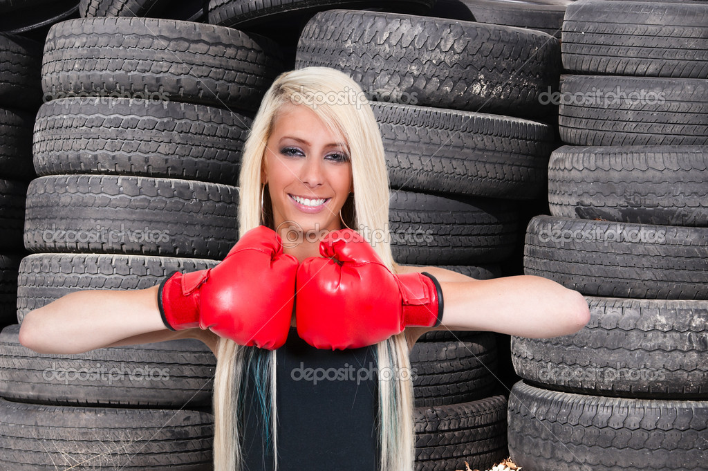 A beautiful young woman wearing a pair of boxing gloves — Stock Photo #8816414