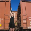 Woman Standing with Railroad Boxcars — Stock Photo