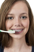Beautiful Teenage Woman Brushing Teeth — Stock Photo