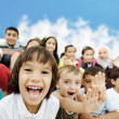 Stock Photo: Crowd of children, different ages and races in front of the scho