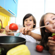 Little girl and boy cooking in the kitchen — Stock Photo #10418541