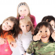 Stock Photo: Group of playful children in studio