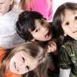 Stock Photo: Group of happy playful children in studio
