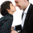Happy father and son playing with noses — Stock Photo