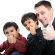 Stock Photo: Portrait of happy father and two sons with thumbs up