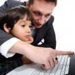 Father and son using laptop — Stock Photo #10418857