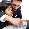 Stock Photo: Father and son using laptop