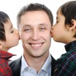 Two sons kissing father — Stock Photo #10418884