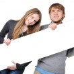 Teenage couple with bilboard — Stock Photo #10419044