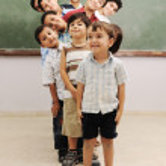 Children at school classroom — Stock Photo #10419100
