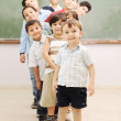 Foto Stock: Children at school classroom