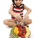 Kid eating fruit cake — Stock Photo #10419250
