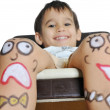 Little boy with painted smileys on his legs — Stock Photo