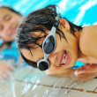 Beautiful kids in pool — Stock Photo #10419312