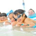 Kids in pool — Stock Photo
