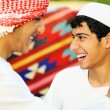 Two brothers, two arabic young - Stock Photo