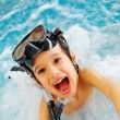Energetic child in pool — Stock Photo #10419465