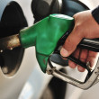 Close-up image of a mens hand refilling the car with a gas pump — Stock Photo