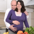 Husband and wife in kitchen — Foto Stock