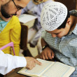 Arabic middle eastern students at school reading Koran — Stock Photo
