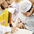 Children at school classroom, reading Koran — Stock Photo #10419786