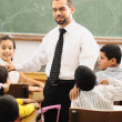 Children at school classroom — Stock Photo #10419921