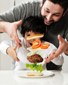 Conceptual photography - flying ingredients of hamburger. — Stock Photo