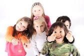 Group of playful children in studio — Stock Photo