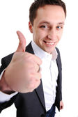 Young man with thumb up — Stock Photo