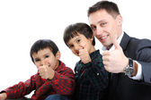 Portrait of happy father and two sons with thumbs up — Stock Photo